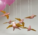 Domestic Flights, 2006 - ceramic, glaze, silver chain, paddlepop sticks, balloons, electrical tape