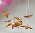 Domestic Flights, 2006 - ceramic, glaze, silver chain, paddlepop sticks, balloons, electrical tape